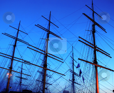 Sailing ship fragment stock photo, Fragment of sailing ship over blue evening sky by Julija Sapic