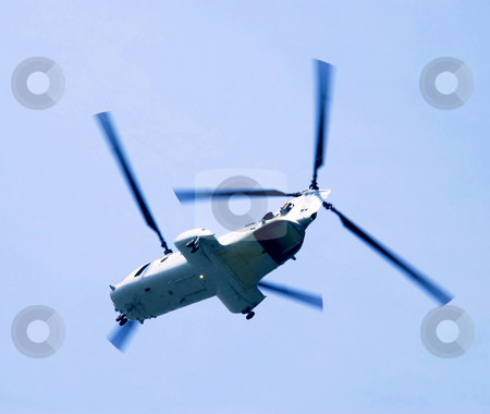 Flying Helicopter stock photo, Flying helicopter over blue sky from bottom by Julija Sapic