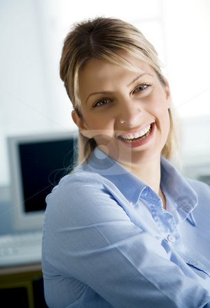 Young happy office worker stock photo, Young business woman or IT student smiling by Liv Friis-Larsen