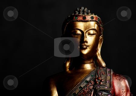 Buddha Statue on Dark Background stock photo, Golden Buddha statue on a dark background by Scott Griessel