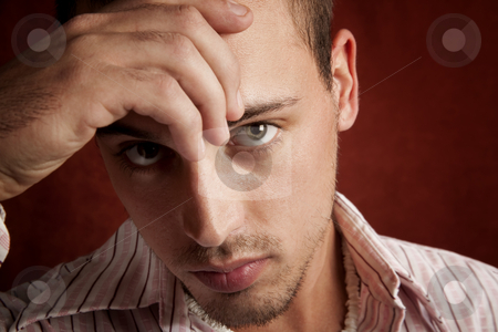 Man in thought stock photo, Young man with stubble in serious thought by Scott Griessel