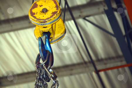 Hoist, hook and chain in a factory stock photo, Hoist, hook and chain in a factory by Chris Alleaume