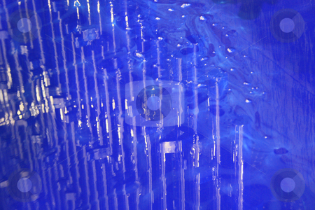Reflection of pipes in paint stock photo, Blue paint reflective pipes that have just been dipped into a dipping tank by Chris Alleaume