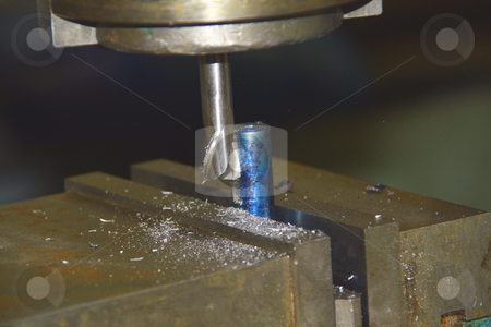 Drill press on metal stock photo, Drill press shaping a piece of metal by Chris Alleaume