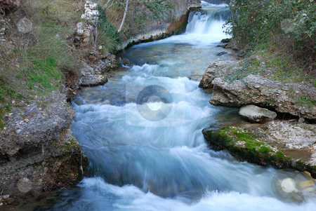 Creek Cascade stock photo, Creek cascade flowing forward with rocks and vegetation on the banks. by Denis Radovanovic