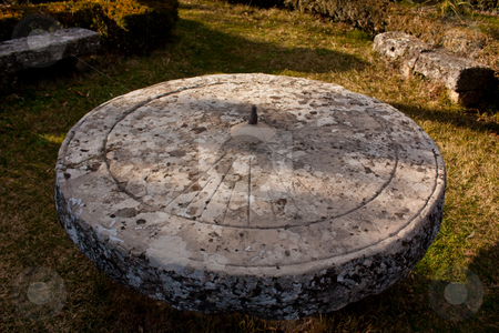 Old sundial stock photo, Very old sundial on a stone platform by Santiago Hernandez