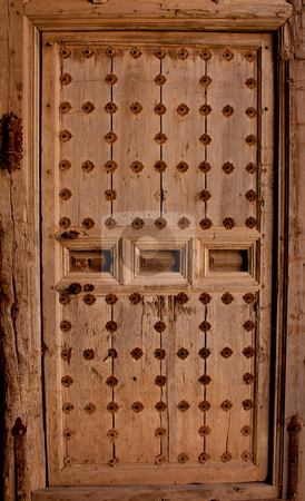 Very old wood door stock photo, Very old wooden door with metal reinforcements by Santiago Hernandez