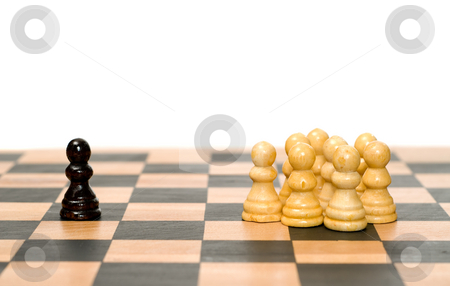 Conflict stock photo, A small group of white chess pawns separated from a single chess piece by Richard Nelson