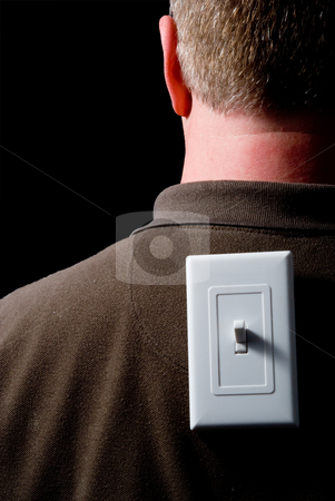 Turned On stock photo, A man with a light switch on his back. by Robert Byron