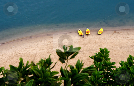 Vacation stock photo, Docked kayaks on South Pacific waters by Audrey Amelie Rudolf