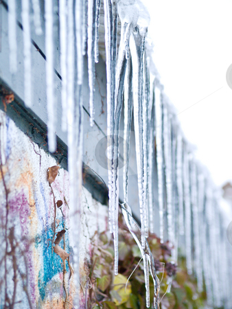 Ice cold Icicles hanging down stock photo, Ice cold Icicles hanging down from a roof top by Phillip Dyhr Hobbs