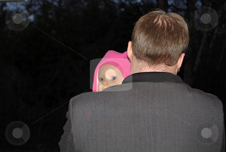 Baby Peeking Over Daddy's Shoulder stock photo, Little baby peaking her eyes out over her daddy's shoulder to see a better view.  Rear view of dad. by Valerie Garner