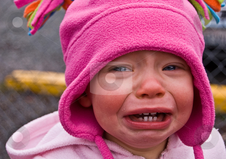 Toddler Girl Crying stock photo, Closeup photo of a toddler girl dressed in pink crying big sad tears that will melt anyone's heart. by Valerie Garner