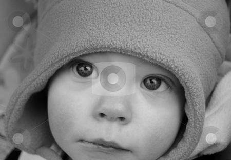 Black and White Photo of a Baby with Haunting Eyes stock photo, Closeup black and white photo of a baby with haunting eyes that pull you in. by Valerie Garner