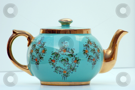 Turquoise and Gold Antique Teapot stock photo, This turquoise and gold hand painted teapot is an antique that has been in my family for many generations.  It's set against a light background and is a rare object. by Valerie Garner