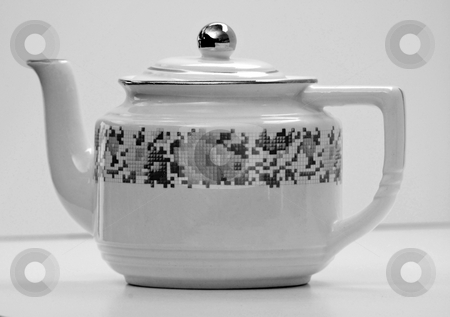 Antique White Teapot with Floral Designs Black and White Photo stock photo, This white teapot with floral designs has been in my family several generations and is an antique.  It has been a unique item and is set as a closeup in a black and white photo. by Valerie Garner