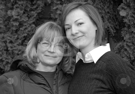 Mother And Adult Daughter Black and White stock photo, Mother and adult daughter share a moment together enjoying each other's company, black and white shot. by Valerie Garner