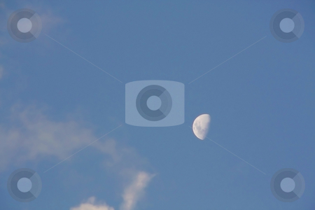 Daylight moonshine stock photo, Moon shining in the daytime against a bright blue sky by Chris Alleaume