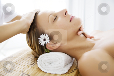 Wellness stock photo, Young female receiving facial massge by Liv Friis-Larsen