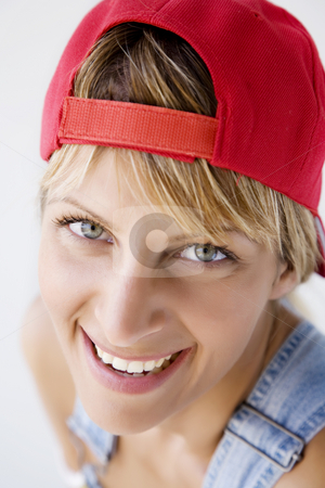 Tomboy stock photo, Closeup portrait of young woman with baseball cap by Liv Friis-Larsen