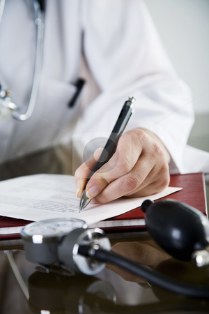 Doctors note stock photo, Closeup  of doctor writing a prescription by Liv Friis-Larsen