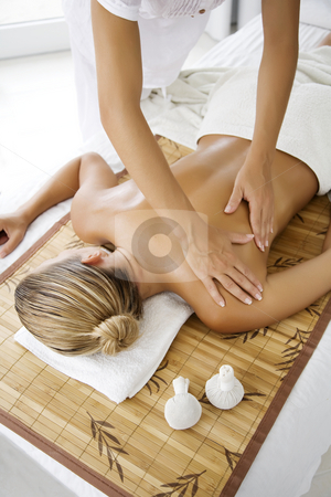 Massage stock photo, Female receiving professional massage by Liv Friis-Larsen