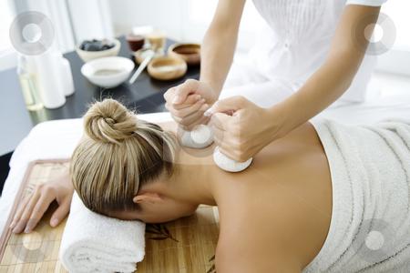 Thai herbal massage stock photo,  by Liv Friis-Larsen