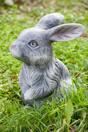 Rabbit statue stock photo, Rabbit statue on green grass backgound by Desislava Dimitrova