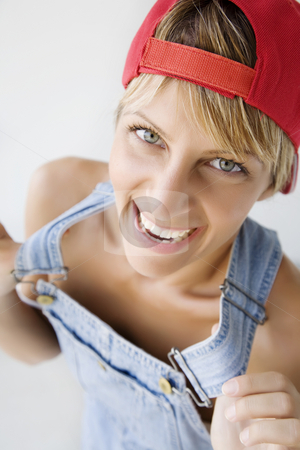 Happy tomboy stock photo, Young female doing a cheeky pose by Liv Friis-Larsen