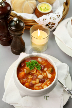 Minestrone Soup stock photo, Delicious minestrone soup with fresh baked bread rolls and butter. by Brett Mulcahy