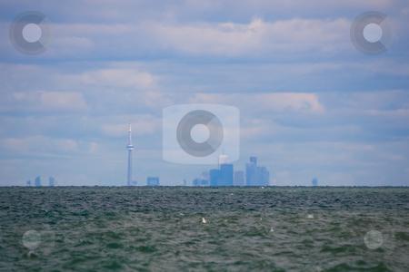 Toronto skyline stock photo, The Toronto skyline, as seen across lake ontario. by Kevin Woodrow