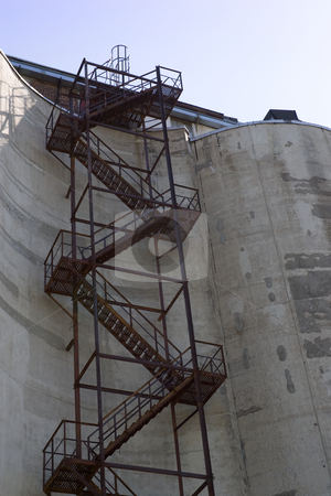 Silo staircase stock photo, Staircase that extends up the side of a grain silo. by Kevin Woodrow