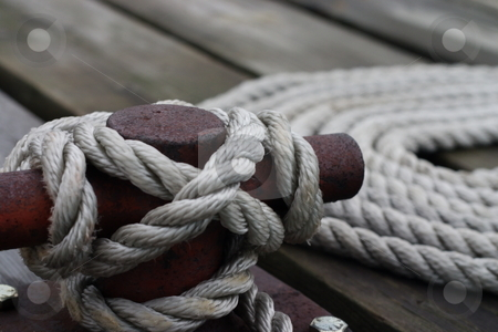 Cleat closeup stock photo, A cleat tied off with a boat line. by Kevin Woodrow