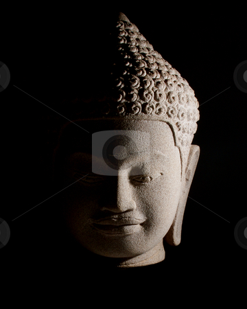 Buddha stock photo, Stone Buddha head. Strong side lighting. Isolated on black. by Martin Darley