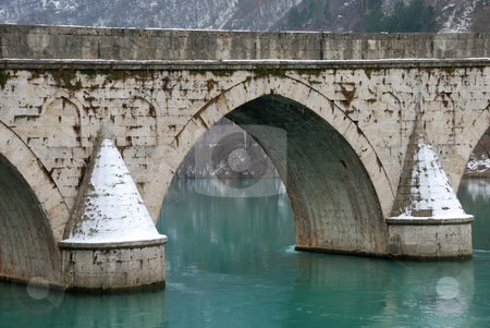 Detail of Bridge on Drina stock photo, Detail of the bridge on the Drina in VIsegrad, Bosnia and Herzegovina on a winter overcast day. by Denis Radovanovic