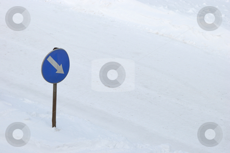 This Way stock photo, Blue traffic sign in snow showing direction. by Denis Radovanovic