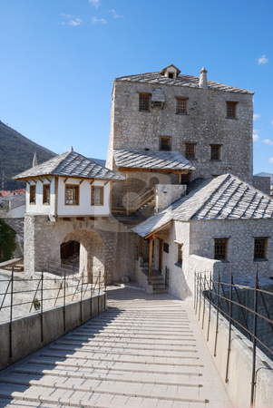 Tower with Gate in Mostar Old Town stock photo, View from the Old Bridge of the west tower and gate in Mostar old town on a sunny day. by Denis Radovanovic