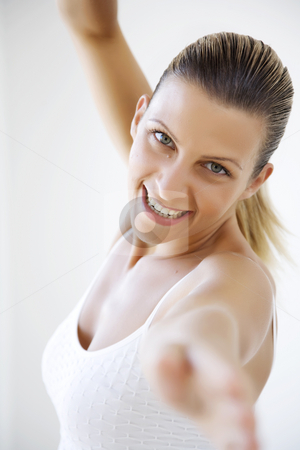 Fitness stock photo, Young female exercising by Liv Friis-Larsen