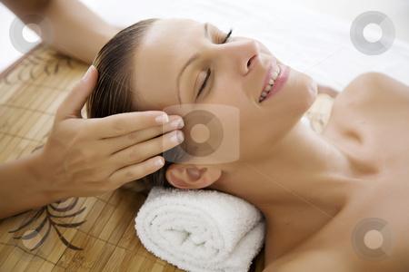 Enjoying treatment stock photo, Female ebjoying a massage by Liv Friis-Larsen