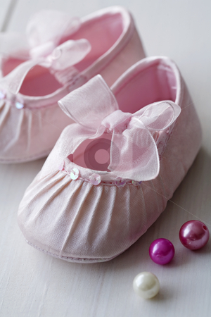 Girls baby shoes stock photo, Closeup of pink satin baby shoes by Liv Friis-Larsen
