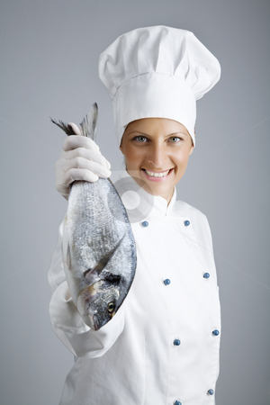 Fresh fish stock photo, Female chef holding up fresh fish by Liv Friis-Larsen