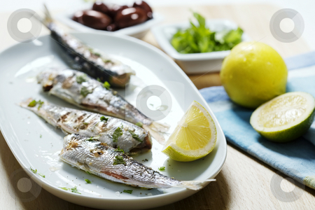 Grilled sardines stock photo, Plate of grilled sardines by Liv Friis-Larsen