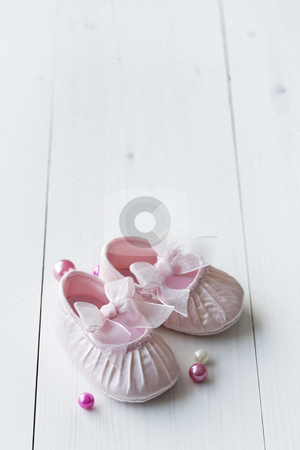 Cute baby shoes stock photo, Little girly baby shoes on a wooden floor, copy space for text, perfect for invitation or card by Liv Friis-Larsen
