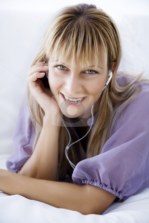 Enjoying music stock photo, Young woman at home listening to music by Liv Friis-Larsen