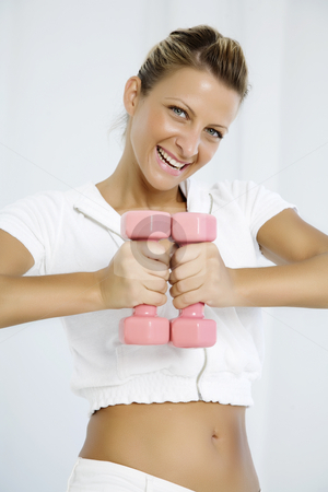 Happy workout stock photo, Young woman posung with dumbbells by Liv Friis-Larsen