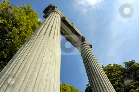Roman remains stock photo, The remains of a Roman building standing isolated, mysterious and dramatic against the sky. Low viewpoint increases drama. by Alistair Scott