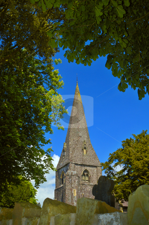 Llanddarog Church spire stock photo, The stone spire of Llanddarog Church, Dyfed, Wales, UK. This imposing Norman church is situated on a hill. Its spire is a landmark for the village and can be seen for miles. by Alistair Scott