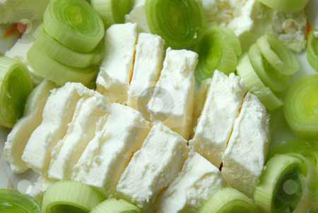 Leek cheese background stock photo, Cut green leek and white cheese slices closeup by Julija Sapic