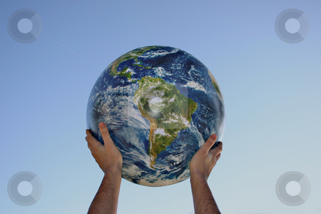 Hands on the World stock photo, An isolated image of two hands holding the world. by Ralph Muzio