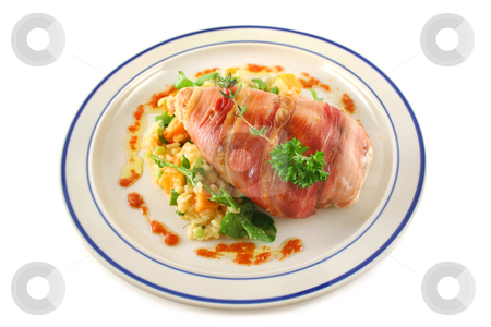Chicken Prosciutto stock photo, Chicken wrapped in prosciutto on pumpkin and rocket risotto. by Brett Mulcahy